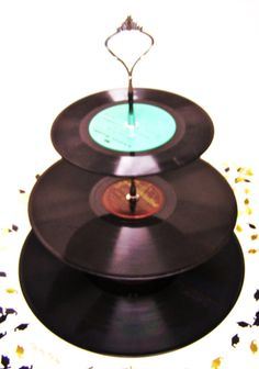 Record cupcake stand  oh my word this with cupcakes with music notes on them and a guitar cake for a themed party would be the most epic thing EVERY!!! Sorry love music and vintage, record do both <3