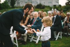 The hand off! Ring bearer + Best Man  Credits: Photography: Divine Light Photography - dlweddings.com @Divine Light Photography, Venue: Rufflands Farm, Red Hook, NY (Hudson Valley)