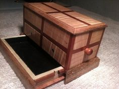 Jewelry box with secret drawer and hidden, magnetic lock