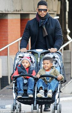Usher and his sons, Usher Raymond V and Naviyd, three.  I LOVE TO SEE A FATHER AND HIS KIDS!  IT'S SO SEXY!