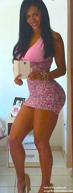 Fit babe with great legs in sexy short dress