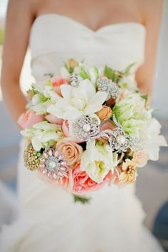 Get Inspired: A DIY brooch and flowers bouquet for the bride! Definitely a creative way to add character to the usual bouquet.