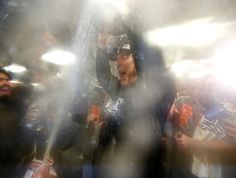 San Francisco Giants manager Bruce Bochy celebrates with the World Series trophy in the clubhouse following their 3-2 win in Game 7 of baseball's World Series against the Kansas City Royals at Kauffman Stadium in Kansas City, Mo., on Wednesday, Oct. 29, 2014.  (Nhat V. Meyer/Bay Area News Group)