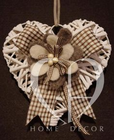 White rattan heart with felt and tapes application