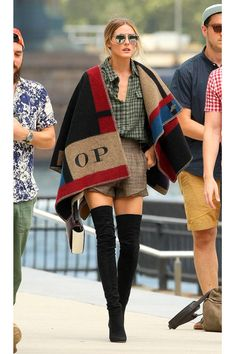 The chic It girls who have proved that the Burberry monogrammed cape is THE jacket of fall'14