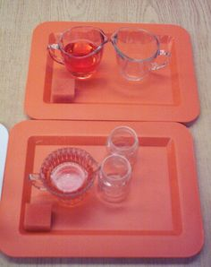 Pouring Liquids - These activities involve pouring liquids from one container into another. You can see that each tray has a small sponge for spillages.