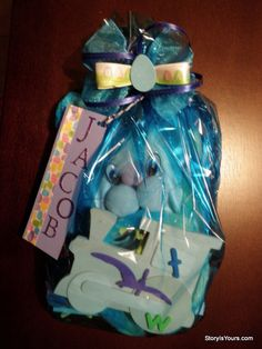 Easter Imagination Basket with Personalized Book, Arts & Craft and Dress-up items. Wrapped in cellophane with Personalized gift tag and bow. Give a meaningful gift this Easter! StoryIsYours.com