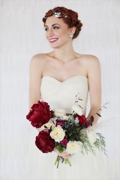 red and white wedding bouquet #weddingbouquet #bouquet #weddingchicks http://www.weddingchicks.com/2014/03/03/silver-wedding-ideas-2/