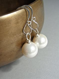 The Magnolia earrings - a classic design, these are easy care lustrous South Sea Shell pearls - white with the merest hint of pink.