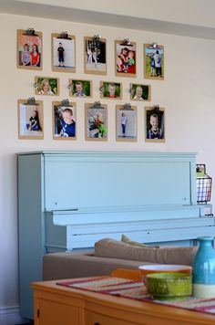 clipboard photo display. could work well for children to display their arts and crafts, too. just change them out as often as they would like.