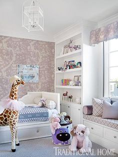 A little girl's room features plenty of purple and stuffed animals. - Traditional Home ® / Photo: Emily Jenkins Followill / Design: Bradshaw Orrell