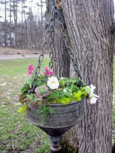 This hanging planter was made from an old funnel, doorknob, and chain.-I would soo do this idea! I always want my garden, to be unique; like me! Not like everyone elses!! That's what makes gardening so much fun!!! It's your own creative expression!! flower containers, garden planters, flower planters, chain, front yards, funnel planter, hanging planters, hanging baskets, front porches