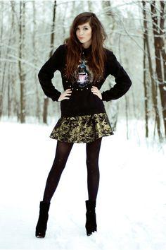 winter fashion scene cute ornate black skirt , black tights, and urban black sweater.