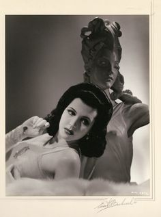 """Ann Miller oversize exhibition portrait by Ernest A. Bachrach. Silver bromide matte borderless 10 3/8 x 13 in. double-weight print of Ann Miller, custom-mounted to 15 x 20 in. presentation mat, signed and dated 1940 (with Deco accent) by Ernest A. Bachrach, and from his private collection. Numbered in the negative """"AM-487C""""."""