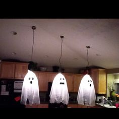Haunted kitchen! Drape sheer material over your kitchen lights, add some spooky dark eyes & a mouth with sticky felt and viola! Your kitchen is haunted! Happy Halloween!