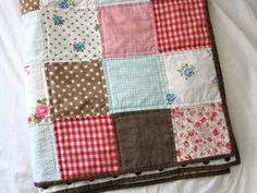 folded baby quilt by sparklecandace, via Flickr