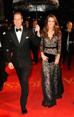 Kate Middleton in black lace evening dress with long sleeves
