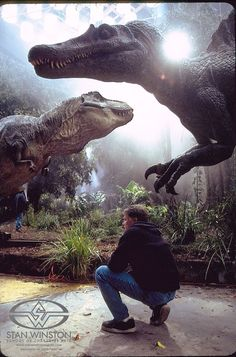 Jurassic Park III director, Joe Johnston lines up a shot of the Spino/T-rex fight on set.