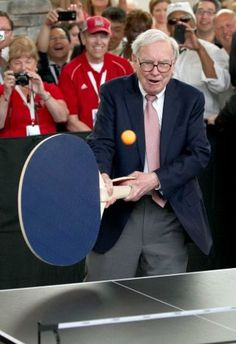 Using a comically oversized ping-pong paddle!