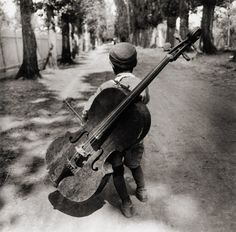 Gypsy boy with cello, Hungary, 1931, by Eva Besnyö.