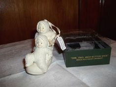 "DEPT. 56 SNOWBABY ""ONE, TWO, HIGH BUTTON SHOE"" BISQUE BOOTIEBABY ORNAMENT"