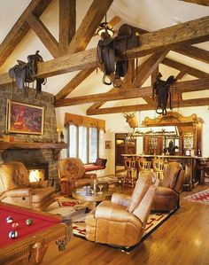 Country living room-saddles in the rafters