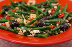 Love this Green Bean Salad Recipe with Hearts of Palm, Olives, Red Pepper, and Feta (could omit the cheese)