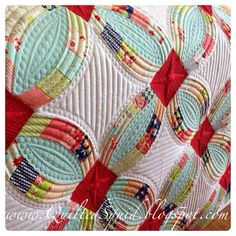 This quilting is gorgeous and the colors are so beautiful! QuiltedSquid Quilting: Metro Rings with Moda Miss Kate Quilt is done!!!