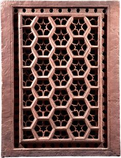 HEXAGONS AND STARS - India (Mughal), 17th century - A carved and pierced double-sided red sandstone jali screen, with an overall design of interlocking hexagons, each containing a six-pointed star.