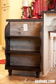 Love this shelf at the end of a cabinet.....by Southern Revivals