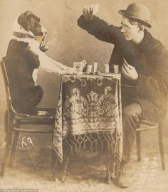 19th Century humorous photograph of a card game between man and dog - looks as though the dog is winning!