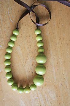 Tutorial; spray paint wooden beads, thread on ribbon.  #Beading #Jewelry #Tutorials