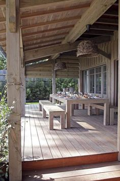 beautiful big porch and long table