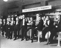 Group of tuxedo'd men at the Walgreen's soda fountain, c.1921, Chicago.