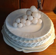 Beautiful stack of white ironstone plates from Georgia's @ www.georgiashomeinspirations.com