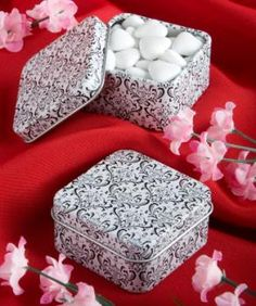 Give your guests a damask design mint tins as your favors   We invite you to fill these little treasures with the treat of your choice including candy, confetti and more, for a favor that really packs a punch!