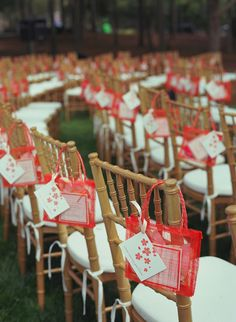 little bags filled with a card for writing a message to the bride and groom, program and rose petals -- so smart!