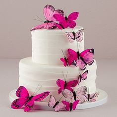How gorgeous are these trailing butterfly cake topper decorations?  So beautiful for a garden wedding theme or outdoor summer wedding.  They come in pink, green, blue, purple, or natural