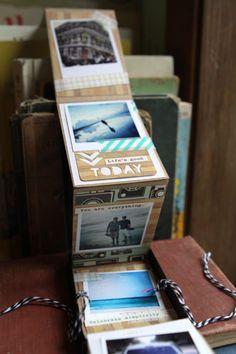 Altered vintage film holder with mini album inside. Scrappergirl