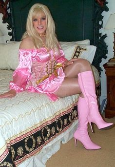 He likes pink and pantyhose and dressing as a girl.  Look how happy he looks in pink boots
