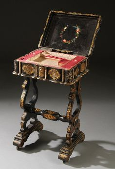AN EARLY VICTORIAN PAPIER-MACHE SEWING STAND