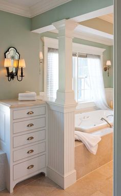 Half-wall with column.  This is what I want to do between the commode & bench, except with shelving on the lower half by commode.