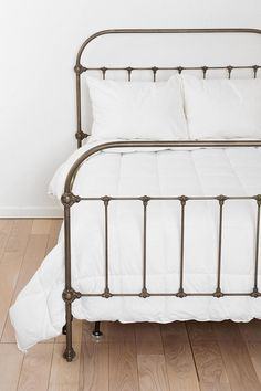 My dream iron wrought bed, so beautiful. This one is actually made of metal to emulate brass it seems. From Plum & Bow, sold by Urban Outfitters (in the States only). urban outfitters bedroom, bed frames, iron bed, master bedrooms, wrought iron, white bedding, bow, guest rooms, white bedroom