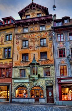 Lucerne, Switzerland - an Apotheke or pharmacy that opened in 1530. A quote painted on the top of the building reads, Amor medicabi lis nullis herbis (there is no herb that will cure lovesickness).