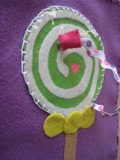 quiet book page - make lollipop with cellophane over it for sound & help kids develop fine motor skills