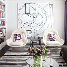 Dream living room in New York City. Platner chairs, modern art, purple tulips!