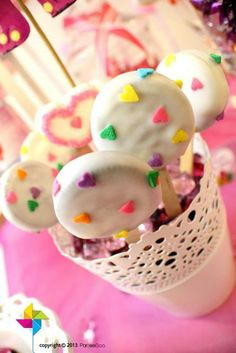Cute Oreo pops with heart sprinkles at a Valentine's party! See more party ideas at CatchMyParty.com!  #partyideas #valentines