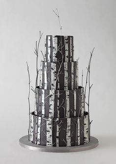 9. Birch Wood Forest Rustic Wedding Cake…    Photo CreditSome rustic wedding cakes look like a single tree, but this incredible fondant cake looks like a forest full of birch wood …