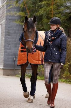 great fall style- orange cooler, brown boots, plaid breeches