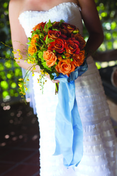 California Wedding: Orange rose bouquet with blue accent bow.